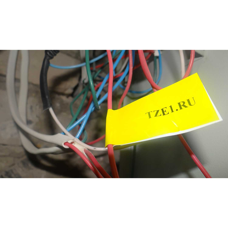 Фото Лента Vell VL-FX631 (Brother TZE-FX631, 12 мм, черный на желтом) для PT 1010/1280/D200 /H105/E100/D600/E300/2700/ P700/E550 {VellFX631} (2)